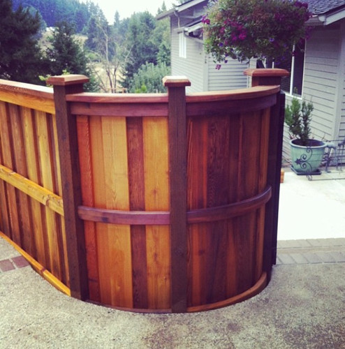 Curved Cedar Fence with Cap & Bevel