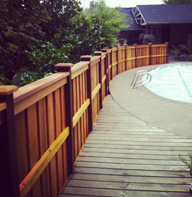 Long View of Curved Cedar Fence with Cap & Bevel