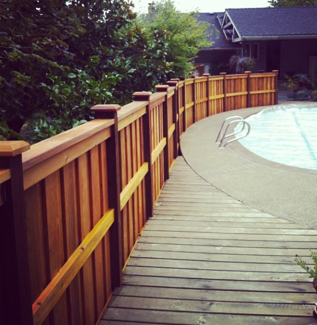 Long View of Curved Cedar Fence with Cap