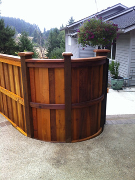 Curved Cedar Fence with Cap & Bevel