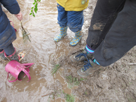 Jumping up and down in muddy puddles!