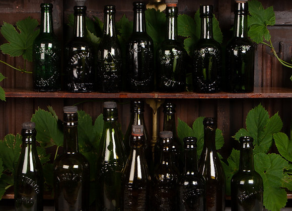 A Group of 17 Green Glass Bottles Early 20th Century