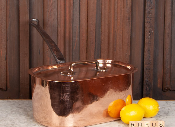 A Large Oval Copper Pan with Lid