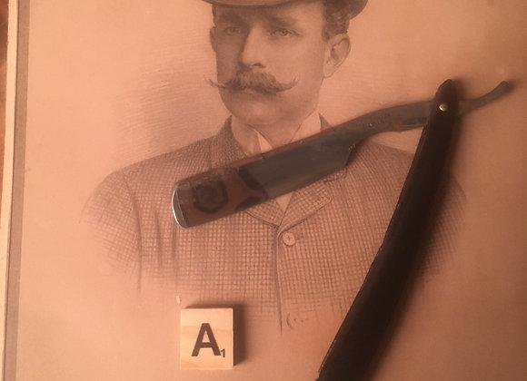 A Victorian Cut Throat Razor with Black Handle