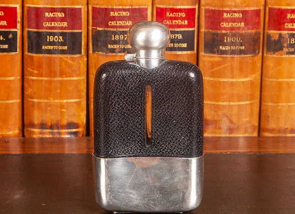 A Late Victorian Leather Covered Hip Flask with Silver Plated Fittings