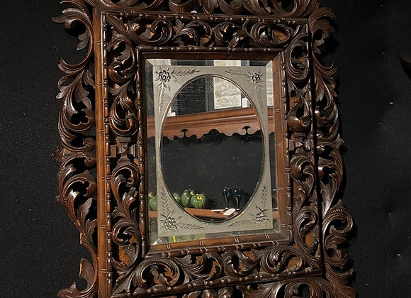 A Large 19th Century Black Forest Mirror