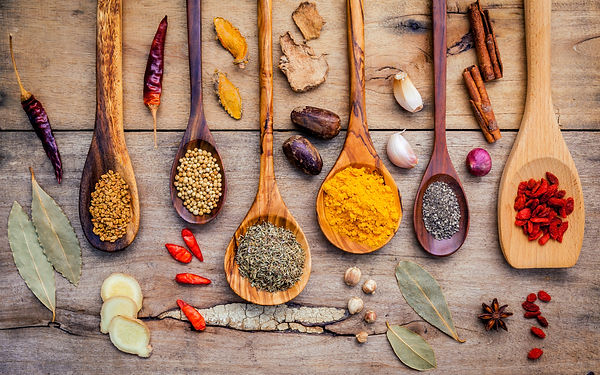 various-herbs-and-spices-in-wooden-spoon