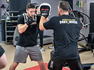 Personal Trainer sparring with a client in lakeland Florida