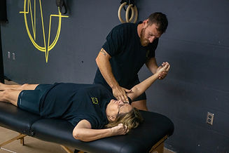 Lakeland gym owner stretching one of his customers