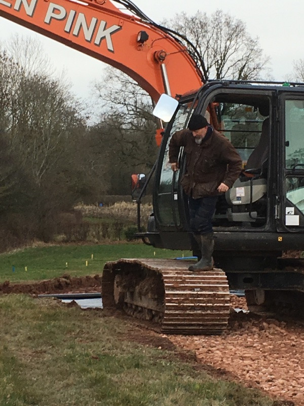Thirteen ton digger and James Rennick pretending to be the driver at Cwtch Cabins & Camping