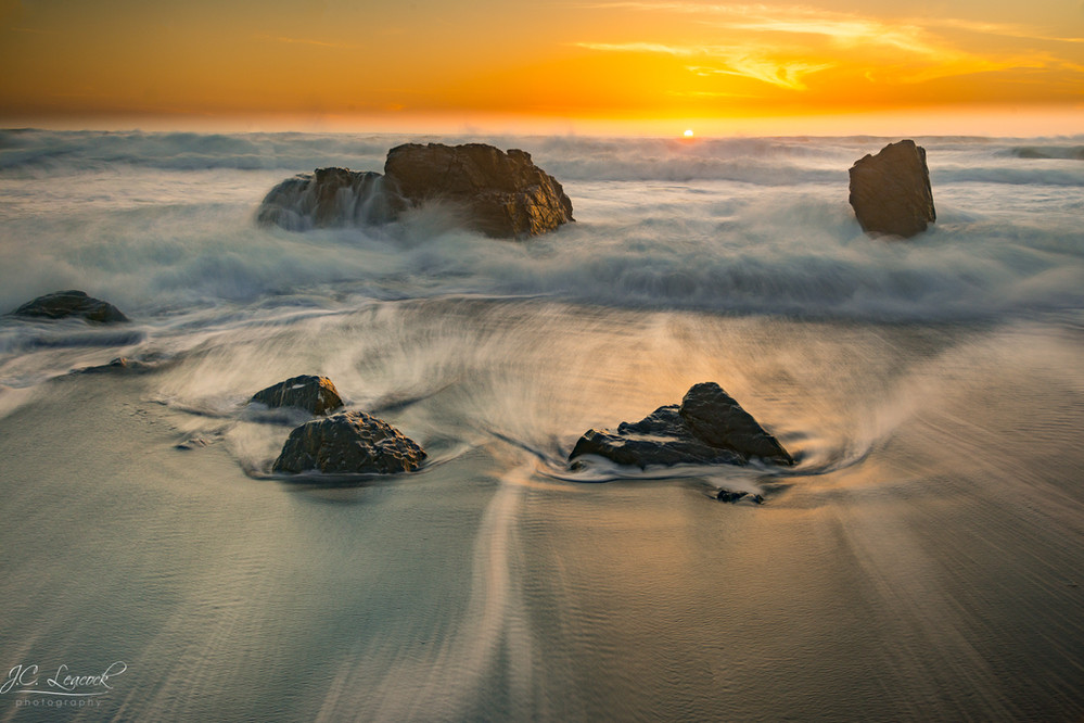 Surf amongst the rocks, at sunset, Westport, California