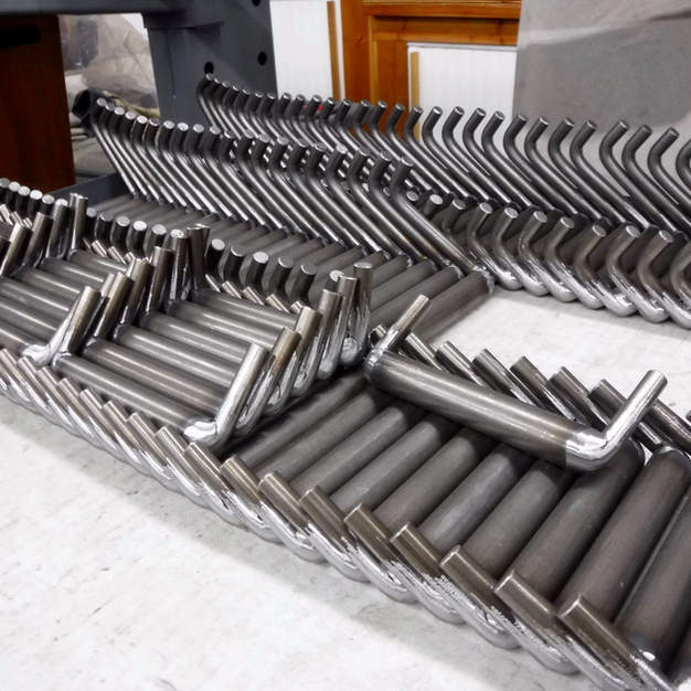 Batch of bench and leg handles after grinding.