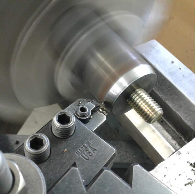 Turning the leg cap welds.