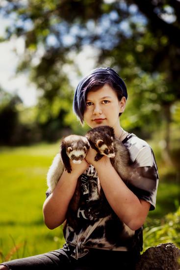 Tween with her Ferrets