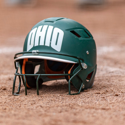 An Ohio softball helmet lies on the pitcher's mound after a victory against University of Buffalo on April 28, 2018. Ohio Bobcats came out victorious 8-0 against Buffalo.