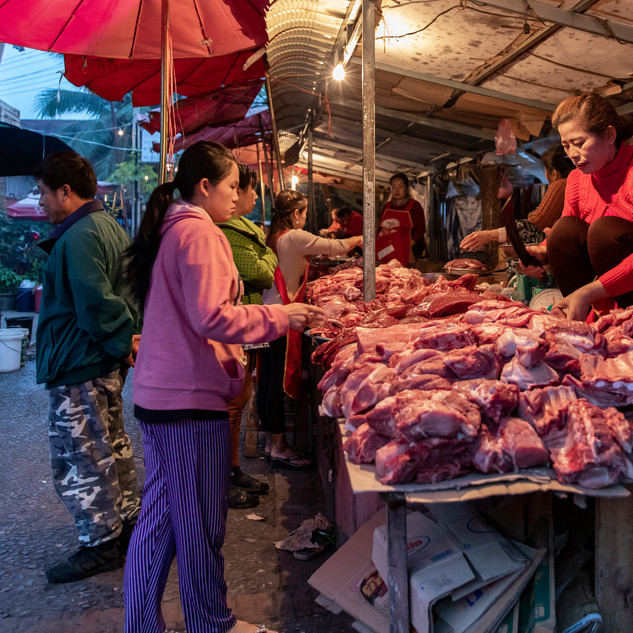 Fresh meat is set out on the market tables for all patrons to see while they are shopping. This participation in the morning market ensures the customer that the meat is the freshest. Once the customer chooses their slabs of meat, the vendor slices it up and packages it for them.