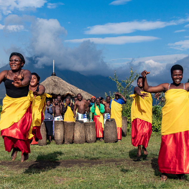 Women show traditional dances during a demonstration in a village that is used to show tourists what life was like on December 21, 2017.