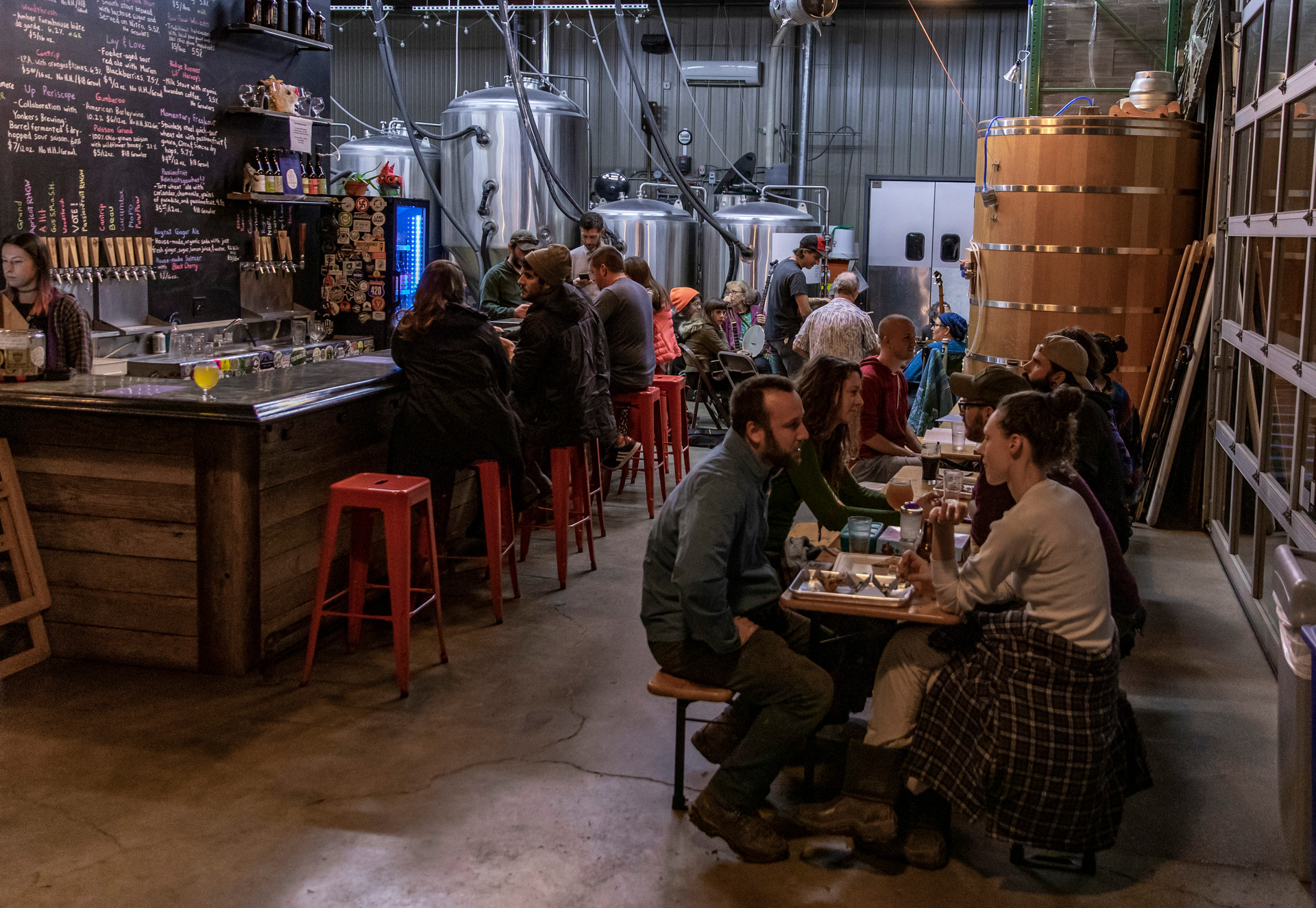 People crowd the taproom on Old Time Music Night on October 17, 2018. Old Time Music Night happens every Wednesday night during the summer and fall seasons. The jam sessions happen outside during those seasons when the weather permits it.