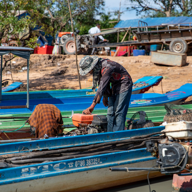 Fishers such as this one is getting ready to go out for the day in Cambodia. There are many fishers that line thir boats up every day in hopes of bringing back a big net full of fish for their source of income.