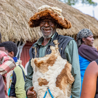 A local villager demonstrates the traditional clothing for a wedding ceremony in Rwanda at the base of Volcanoes National Park on December 21, 2017.