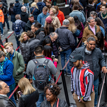 Lines of people wait for TKTS booth to open in Times Square in New York City on April 1, 2018. TKTS offers Broadway tickets for that day at a discount and people line up early in the morning in hopes of getting those tickets.