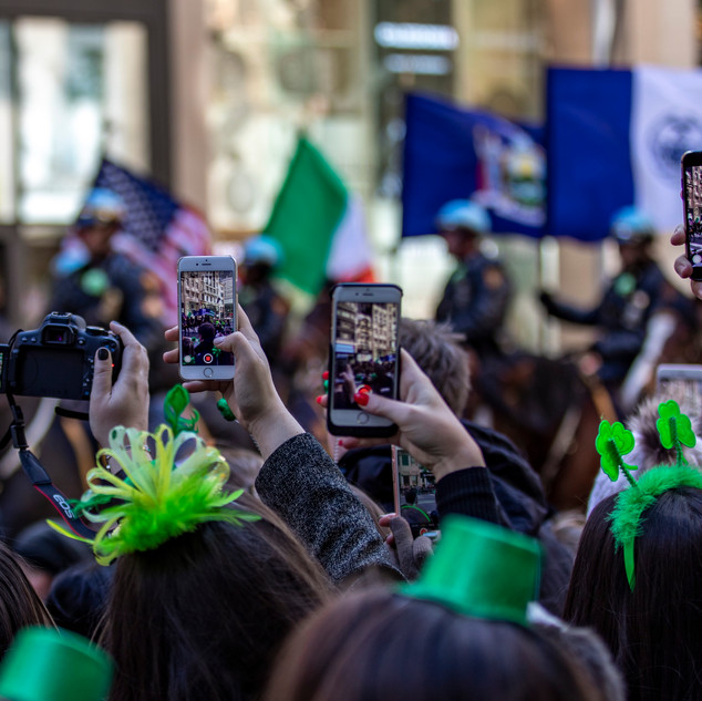 People record and take pictures of the Saint Patrick's Day Parade on 5th Avenue of New York City on March 17, 2018.