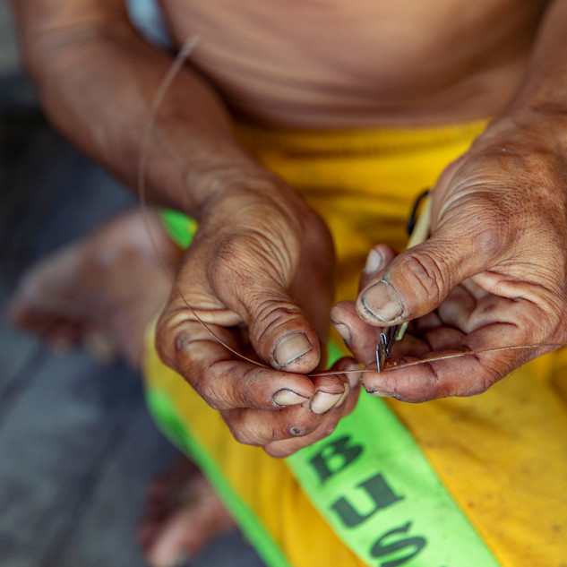 FNPF member Hendri weaves a ring made from local plants that can only be found in Tanjung National Park, Borneo, Indonesia. These rings are offered as souvenirs to tourists that come and help FNPF weekly.