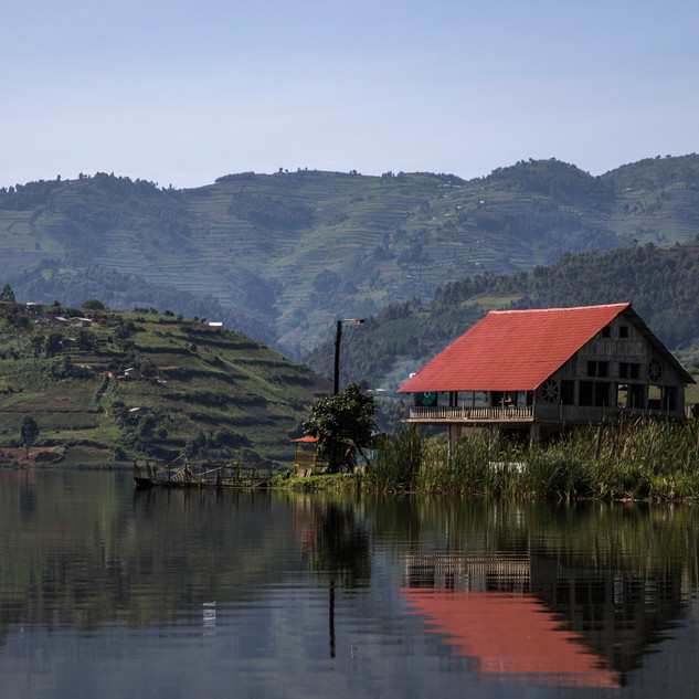 An abandoned house rests on a lake near Kasese, Uganda. Houses like this belongs to fishermen that would take their small boats out to fish for the day.