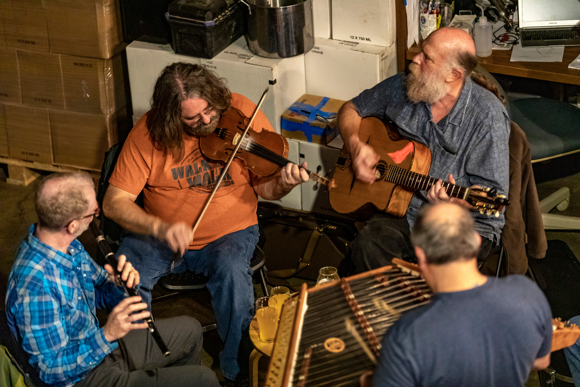 From right to left, Ed Newman, Chris Ridgway, Rusty Smith and Lynn Shaw participate in Celtic Night at Little Fish Brewing Company in Athens, Ohio, on October 30, 2018. Celtic Night is every Tuesday during the summer and fall in the taproom. Little Fish Brewing Company packed with customers in Athens, Ohio, on October 20, 2018.