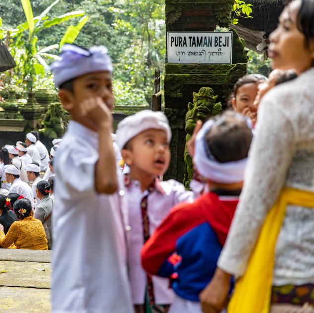 Local Indonesians pray at Batukaru Temple in Bali, Indonesia early in the morning.