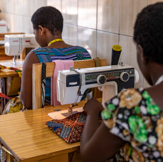 A woman uses a sewing machine in Kigali, Rwanda at a woman's center used to educate women on December 19, 2017.