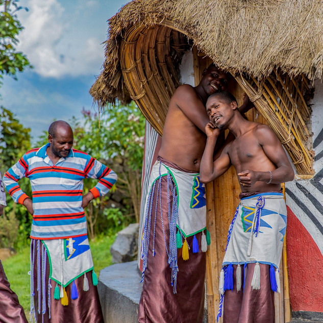 Men show what wedding ceremonies were like back in the 1800s in a village in Rwanda at the base of Volcanoes National Park, Rwanda on December 21, 2017.