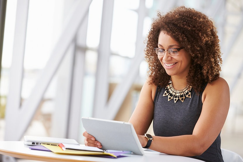 Young African American woman working with tablet in office.jpg