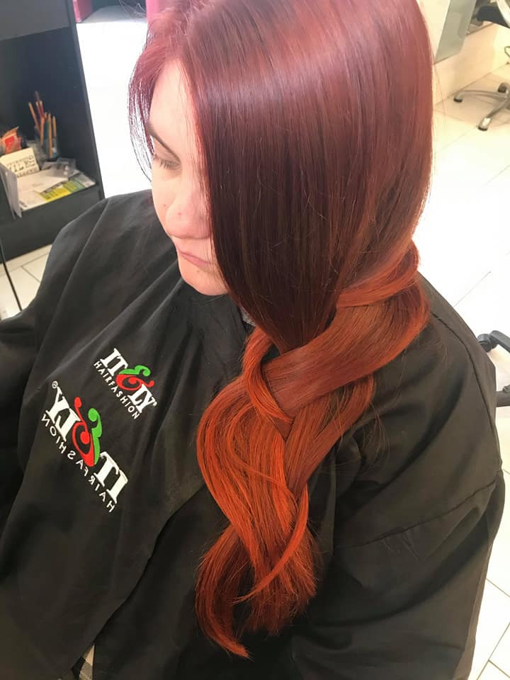 copper red hair in loose plait