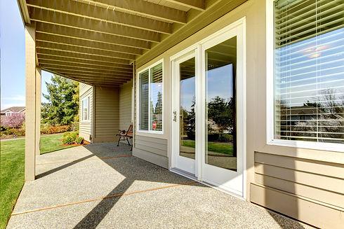 Backyard walkout deck with concrete floo