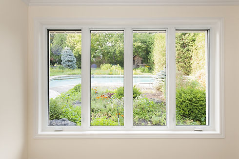Large four pane window looking on summer