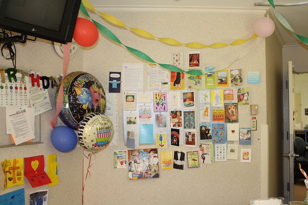 The birthday cards displayed in Art's hospital room.