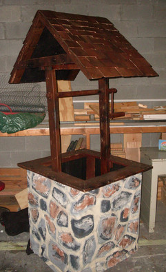 Well faux stone with wood top.jpg