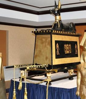 Anubis sitting on pedestal