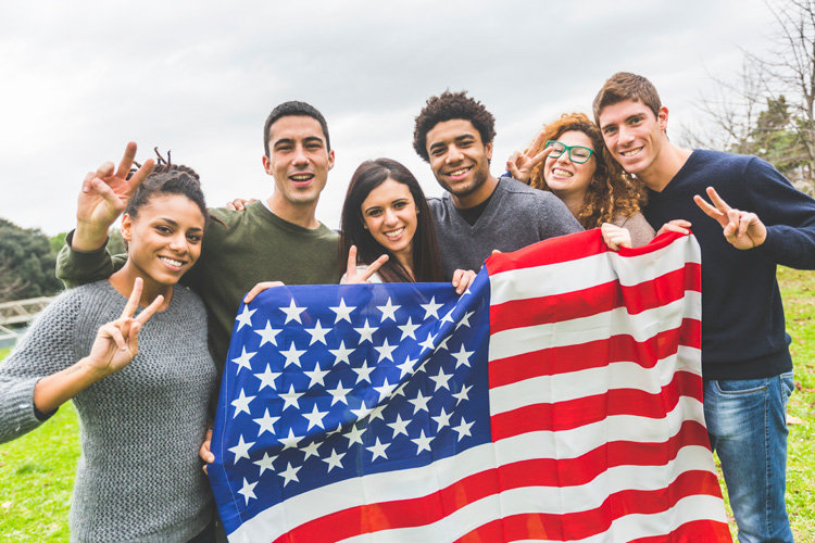 american-students-posing-with-usa-stars-and-stripes-flag.jpg