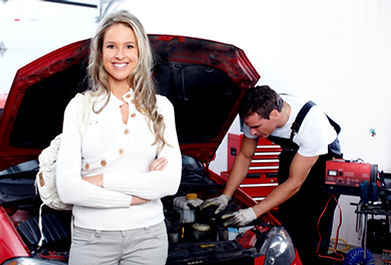 Professional auto mechanic and woman in
