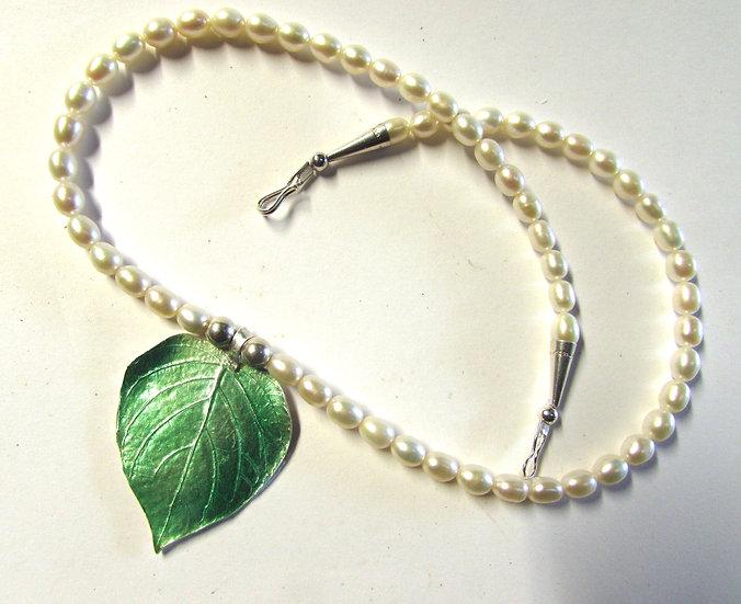 Fine Silver Enameled Mango Leaf on a pearl strand.