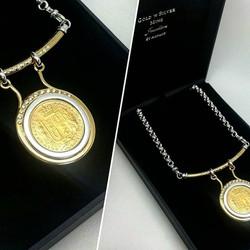 A recent custom make...a unique feature pendant, diamond set coin frame, showcasing customers 1886 s