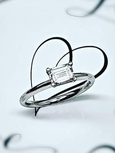 Platinum and Emerald Cut Diamond Solitaire Ring