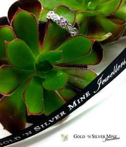 Pretty 9ct Floral design ring set with Signity cut natural rubies,  and diamonds.jpg Customised to c