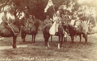 Miss Flint as Australia leading six Diggers on horseback