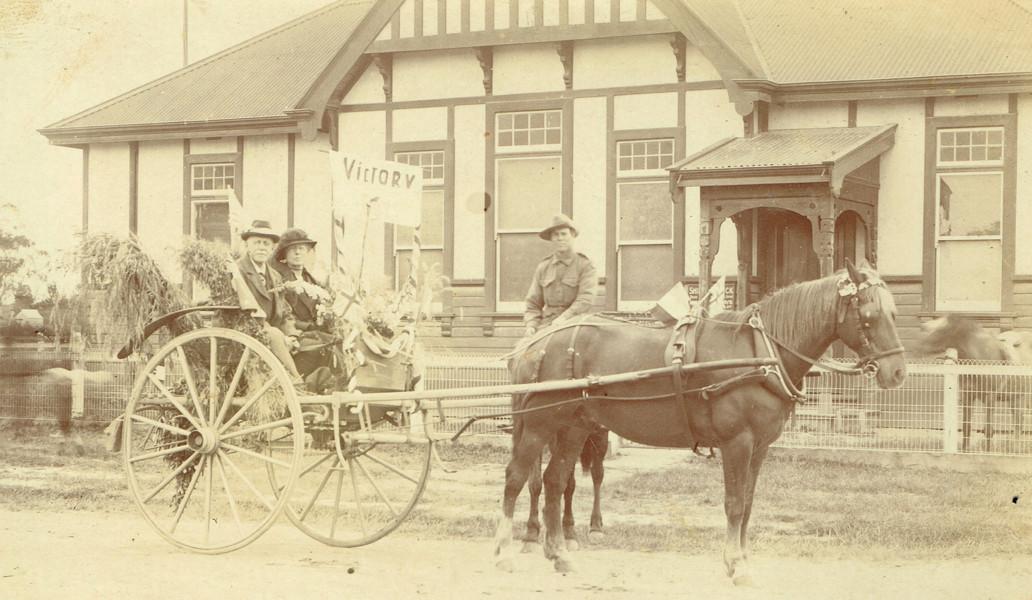 "Bert Ellett with a ""Victory"" jinker outside of the Berwick Shire Chambers"