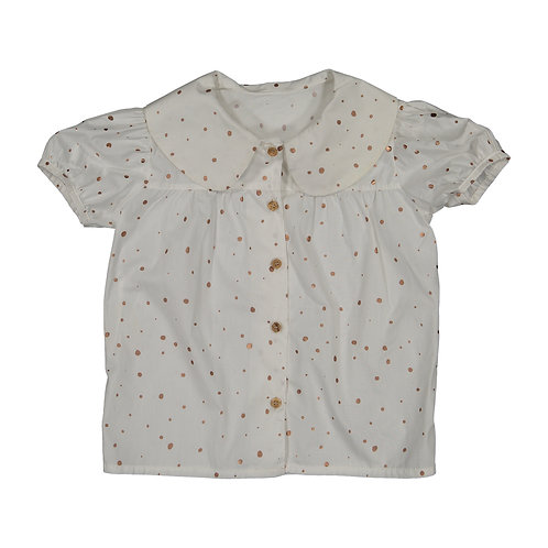 white blouse with golden polka dots