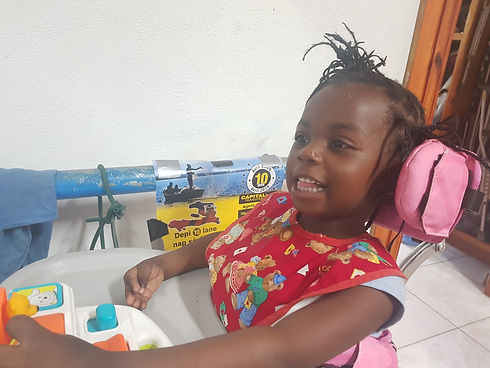 A young girl in a wheelchair being treated at Bethesda Medical Center in Haiti