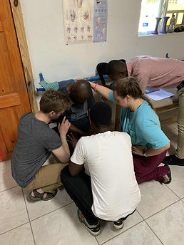 Volunteers pray with a patient at Bethesda Medical Center